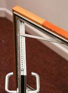 Lightweight aluminium door with door restrainer
