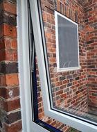 Close up of open aluminium casement window