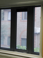 Aluminium drop back window with integral security mesh